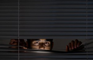 Man almost lynched to death after spying on his neighbour's love making session.